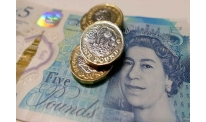 BOE makes unexpected forecasts, pound down anyway