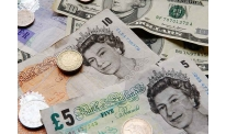 Sterling down again, UK Cabinet hit by new quits