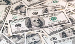 US dollar backs down at moderate pace