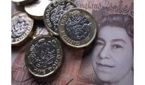 Pound maintains range after Brexit vote, dollar slightly improves