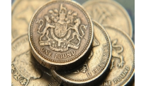 Sterling falls to bottom driven by inflation report