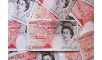 Sterling posts slight rebound by day on upcoming reports