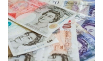 UK labor report pushes sterling up to session top