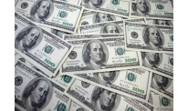 US dollar losing grounds depressed by inflation report