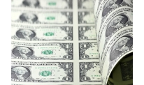 US dollar trims previous gains driven by Federal Reserve meeting
