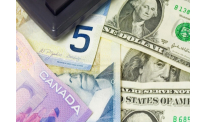 USD touches bottom vs CAD on released economic reports